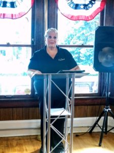 Michele Sandridge speaks on behalf of the Auxiliary on the Centennial Celebration